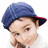 pic of cunning  - Portrait of a little boy with cunning eyes wearing a cap - JPG