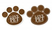 stock photo of paw  - Paw print stickers with text love pet and stars - JPG