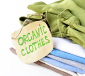 foto of naturalist  - stack of multicolored clothing with organic label - JPG