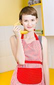 Cute Girl Talking On Fruit Phone In Kitchen