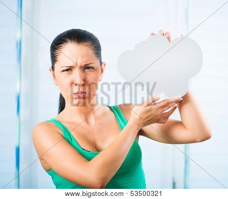 sulky young brunette woman holding a white cloud for text