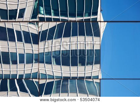 Abstract Distorted Reflections Of Walls In Windows Of Modern Office Building