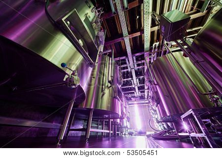 Rows of tanks at microbrewery, low angle view