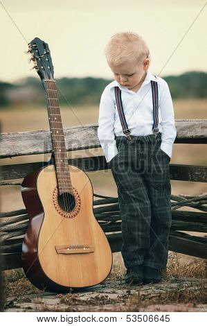 cute little boy with guitar