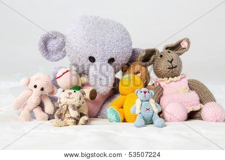 A collection of knitted soft toys in the studio
