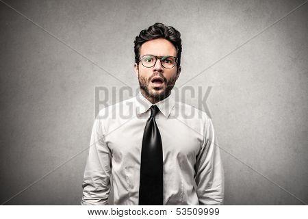 portrait of amazed businessman