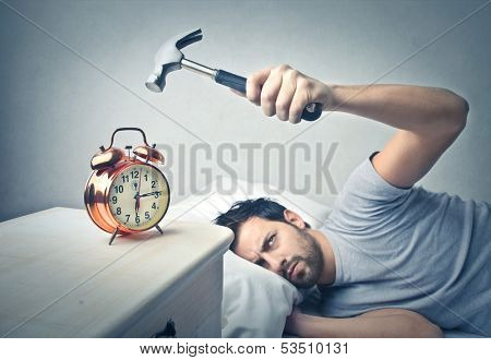lazy man splits alarm clock with hammer