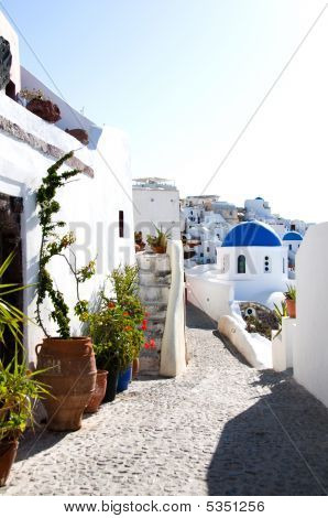 Street Scene With Blue Dome Church And Cyclades Architecture Santorini Greek Islands