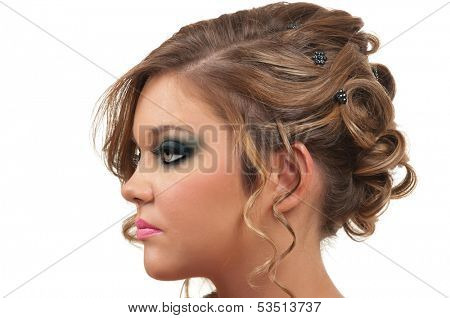Young woman with beautiful hair do and smokey eye make up
