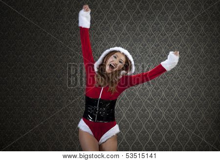 Mrs. Santa is jumping with joy.