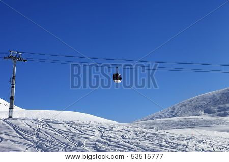 Gondola Lift And Off Piste Slope At Nice Day