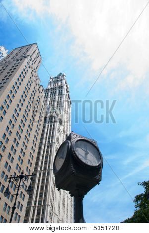 Clock with modern building