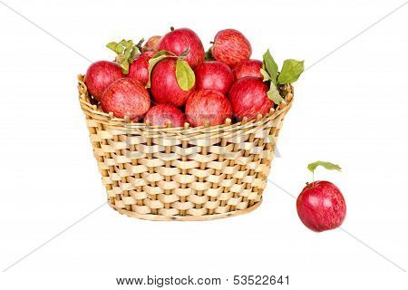 Basket Of Ripe Red Apples With Green Leaves Isolated On White