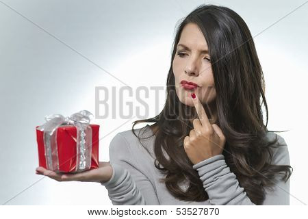 Woman Looking At A Gift With A Puzzled Look