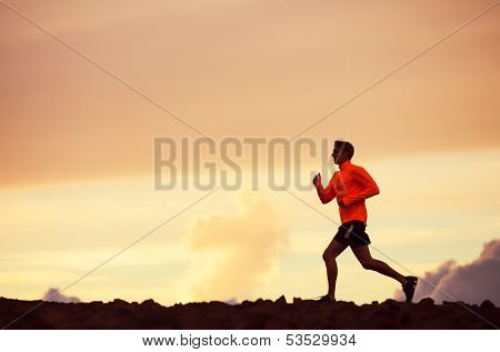 Male runner silhouette, Man running into sunset, colorful sunset sky