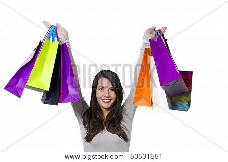 Jubilant Woman Holding Aloft Shopping Bags