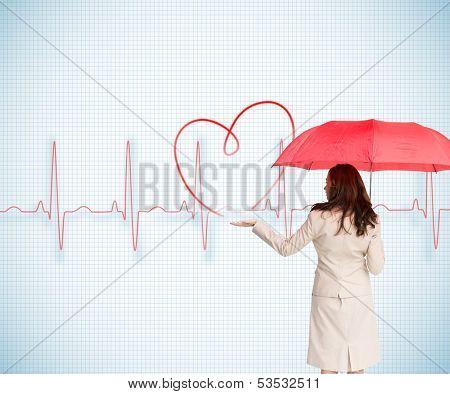 Composite image of brunette businesswoman holding umbrella