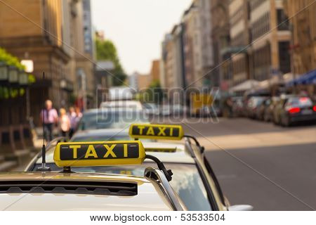 Taxi Waiting In Front Of Another One