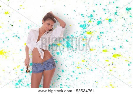 Young woman in blue jeans shorts over graffiti background