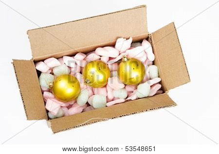 Top View Of Cardboard Box With Christmas Balls