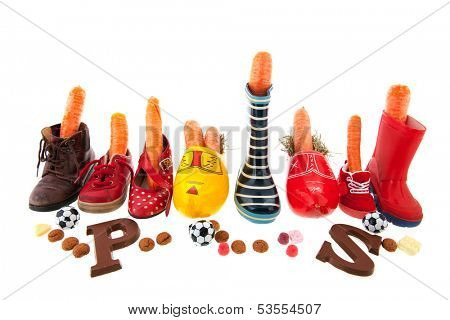 Row shoes with carrots for the horse isolated over white background