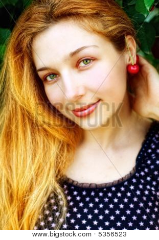 Happy Joyful Woman With Cherry Fruit At Ear
