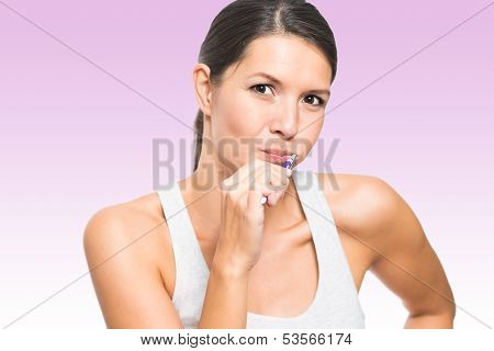 Attractive Woman Brushing Her Teeth