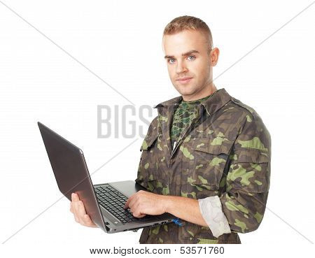 Young Army Soldier With A Laptop