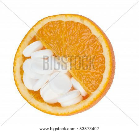 Close Up Of Orange And Pills Isolated - Vitamin Concept