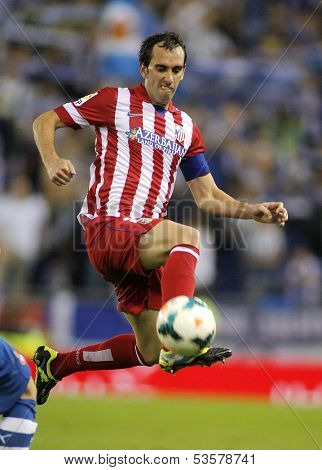 BARCELONA - OCT, 19: Diego Godin of Atletico de Madrid in action during a Spanish League match against RCD Espanyol at the Estadi Cornella on October 19, 2013 in Barcelona, Spain