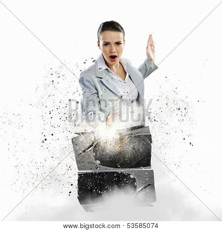 Image of young businesswoman damaging computer processor