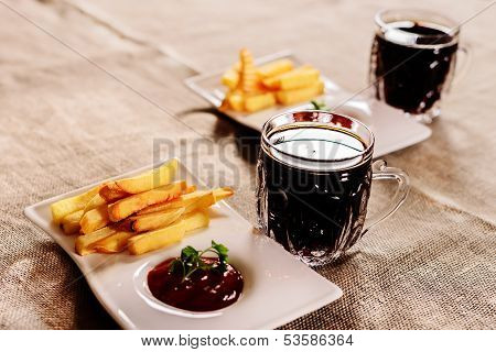 French Fries And Sauce Dish With  Kvass