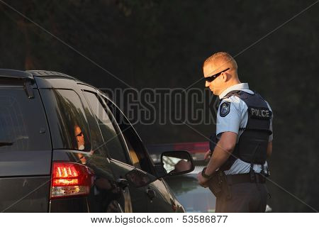 Ningi, Australia - November 9 : Unidentified Police Directing Traffic Away From Bush Fire Front As I