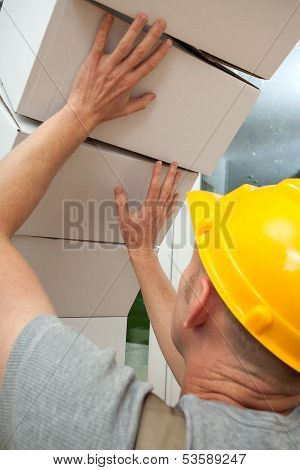 Boxes Falling On Worker