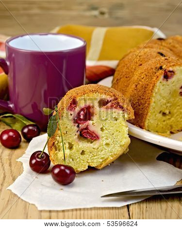 Cake With Berries Cherries And Mug On The Board