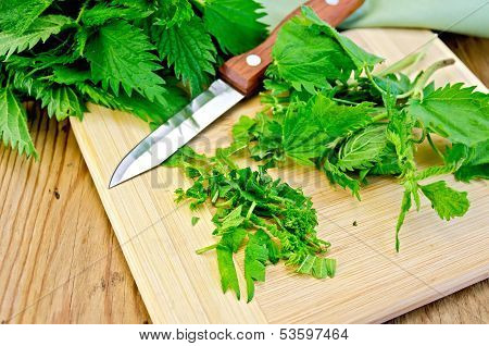 Nettle On The Board With A Knife And Napkin