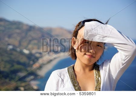 Young Woman Protecting From The Sun