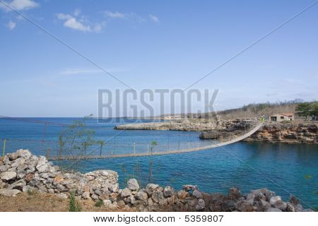 Wooden Bridge On A Rocky Seashore