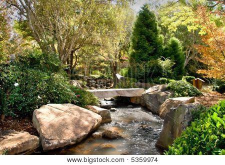 Gentle Stream With Stone Bridge