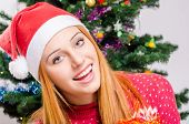 stock photo of merry chrismas  - Girl in front of Christmas tree - JPG