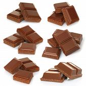 stock photo of bitters  - Broken milk chocolate bar set isolated on white background - JPG