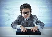 stock photo of computer hacker  - Young programmer writes new software with computer - JPG