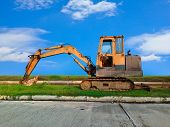 picture of heavy equipment operator  - Heavy Duty Construction Equipment Parked at Worksite - JPG
