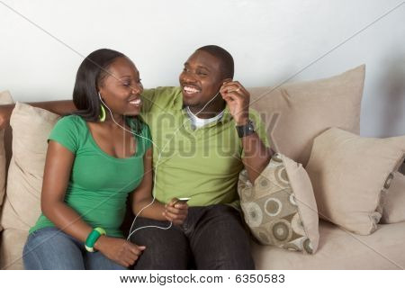 Happy Young Ethnic Black Couple Listening Music