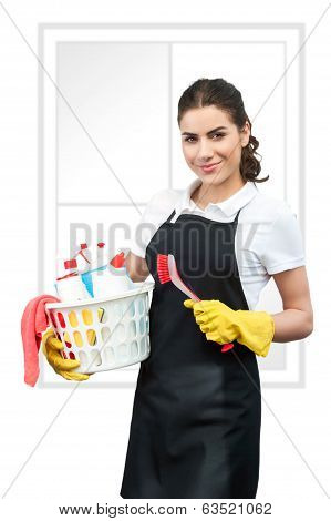 Portrait of cleaning lady holding a brush and a basket