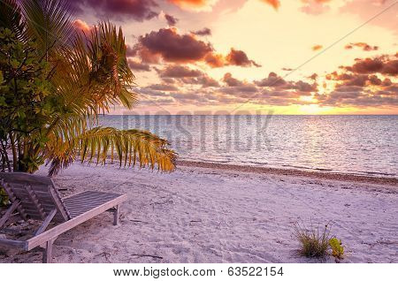 Empty Beach Chair In The Tropical Beach In The Maldives At Sunset