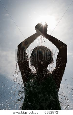 Spashing Water On Silhouette Woman