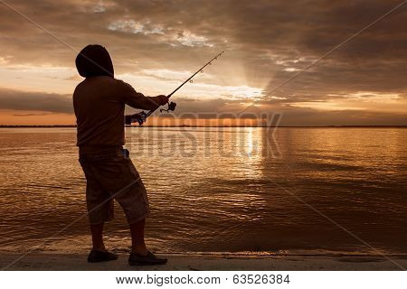 Silhouette Of A Fisherman By Sunset