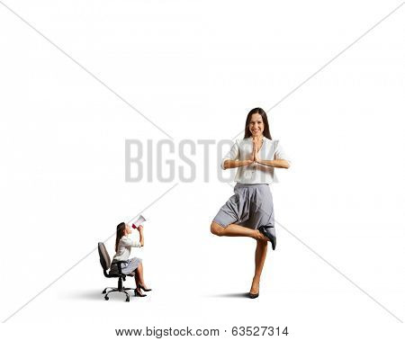 small aggressive woman screaming at big calm woman in asana. isolated on white background
