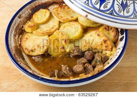 Moroccan sweet potato and beef tagine cooked in the bowl, high angle view. A traditional dish from Fez